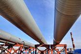 Above-ground pipeline, lower shot against blue sky — Stockfoto