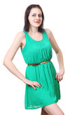 Caucasian girl 18 years old in short green dress. — Stock Photo