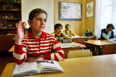 Russian, country school, classroom, schoolgirl raises his hand. — Stock Photo