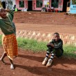 African children playing outdoor, in a small Tanzanian town — Stock Photo #44693943