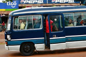 Africans people are traveling in the cabin blue local bus — Stock Photo