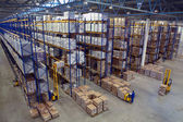 Interior large warehouse with freight stacked high. — Stock Photo