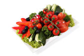 Assorted vegetables on plate isolated on white background. — Stock Photo