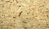 Fibre board pressed wood panel used for construction, with a nice texture usable as background — Stock Photo