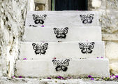 White staircase with balck butterfly — Stock Photo