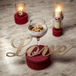 Love sign with candels on wooden background — Stok fotoğraf