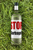 Garbage on the grass — Stock Photo