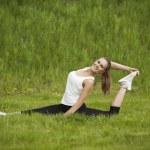 Girl doing exercises outdoor — Stock Photo #26447021