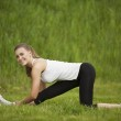 Girl doing exercises outdoor — Stock Photo #26447023
