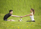 Sportive happy couple in meadows — Stock Photo