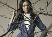 The girl in the branches — Stock Photo