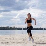 Girl runs along the beach — Stock Photo #27666253