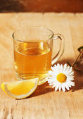 Green tea with chamomile and lemon — Stock Photo