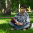 Man relaxing in the park — Stock Photo