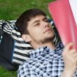 Man lying on the grass — Foto Stock