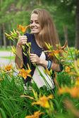 Girl in flowers — Stock Photo