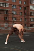 Stretching on the street — Stock Photo
