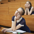 Tired student in the classroom — Foto de Stock