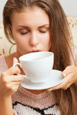 Girl with closed eyes takes a sip of tea — Stock Photo