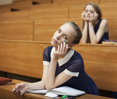 Tired student in the classroom — Stock Photo