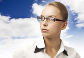 Girl in a blouse on background of sky — Stock Photo