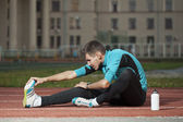 Stretching before exercise — Stock Photo