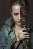 Beautiful girl with an electric guitar — Stock Photo