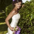 Fashionable Bride in the park — Stock Photo