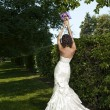 Portrait of beautiful fashionable bride in the park — ストック写真