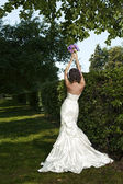 Portrait of beautiful fashionable bride in the park — Stock Photo