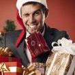 Happy guy with packages — Stock Photo #32748175