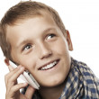 Young man talking on the phone and smiling — Stock Photo #32749583