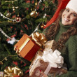 Beautiful girl with lots of gifts — Stock Photo