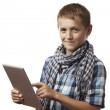 A boy and a tablet computer — Stock Photo