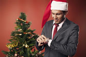 A businessman looks at Christmas time — Stock Photo