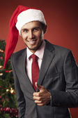 The guy shows thumb up in Christmas — Stock Photo