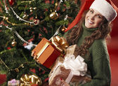 Beautiful girl with lots of gifts — Foto de Stock