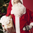 Boy dressed as Santa Claus with shopping — Stock Photo