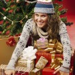 Stock Photo: Girl gave lot of gifts