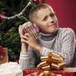 Stock Photo: Boy unpacking Christmas gifts
