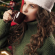 Beautiful girl is drinking coffee on Christmas — Zdjęcie stockowe