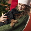 Beautiful girl holding a puppy — Stockfoto