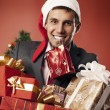 Happy man carries gifts — Foto Stock