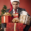 Man carries gifts — Stock Photo