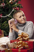Boy unpacking Christmas gifts — Stockfoto