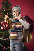 Young shoppers at Christmas — Stock Photo