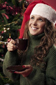 Beautiful girl is drinking coffee on Christmas — Foto de Stock
