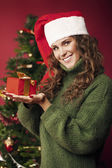 Beautiful girl holding a Christmas gift — Stock Photo