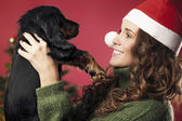 Girl presented with a puppy — Stockfoto