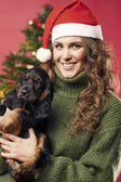Pretty girl with a puppy — Stockfoto